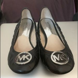 Michael Kors black flats wore once.